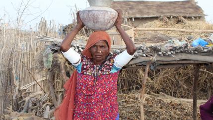 Woman in Pakistan retrieves water