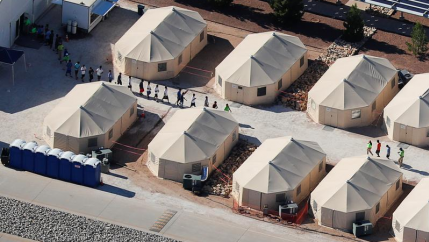an aerial view of a tent camp for detained migrant children in the US