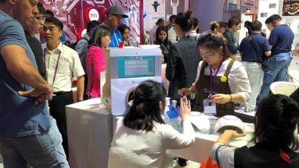 People visit a nail polish booth at the China Import and Export Fair in Guandgong province, China.