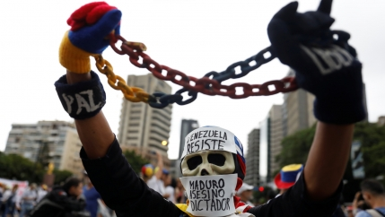 A demonstrator wears a mask at rally in Caracas, Venezuela, May 1, 2017.