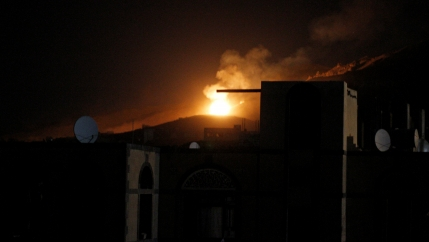 An explosion at a military arms depot is seen after it was hit by a Saudi-led air strike on the Nuqom Mountain overlooking Yemen's capital Sanaa, October 14, 2016.