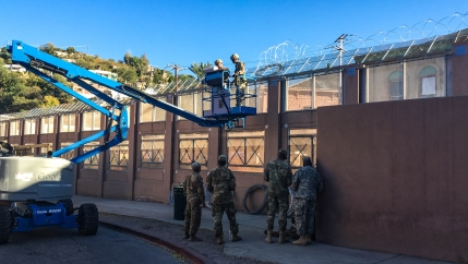 US Army soldiers install razor wire