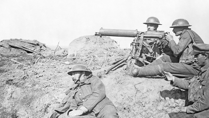 British Vickers machine gun crew hold their guns.