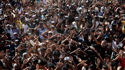 Hundreds of Rohingya refugees shout slogans as they protest against their repatriation