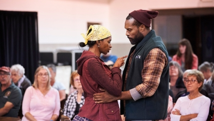"Jenny Jules and Benton Greene in the Mobile Unit National Tour of ""Sweat,"" written by Lynn Nottage and directed by Kate Whoriskey, in Ravenna, OH during a free tour to 18 cities in the Midwest."