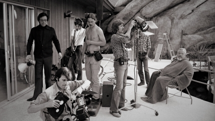 "Orson Welles, Peter Bogdanovich and the crew on the set of ""The Other Side of the Wind."""