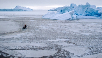 A small boat heads out into the sea ice in western Greenland.