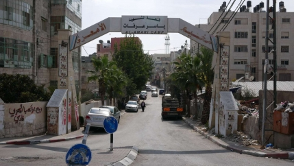 The white gated entrance to the Am'ari camp.