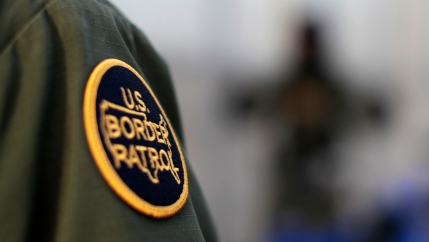 In this close-up photo, a logo patch is shown on the uniform of a US Border Patrol agent.
