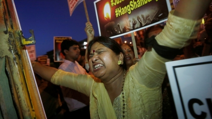 A woman shouts slogans during a protest against the rape of a ten-year-old girl, in the outskirts of Delhi, India, April 25, 2018.