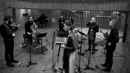a black and white Herrera and her band in a recording studio