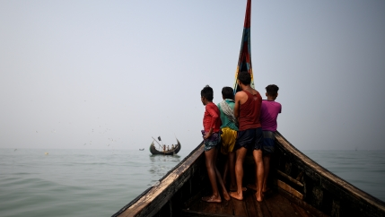 Rohingya refugees crew on a fishing boat
