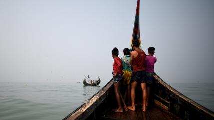 Rohingya refugees crew on a fishing boat