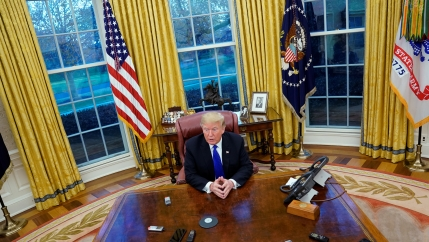 President Donald Trump answers questions during an exclusive interview with Reuters journalists in the Oval Office at the White House in Washington,  DC on December 11, 2018. Asked about his past business connections with Russia, Trump said,