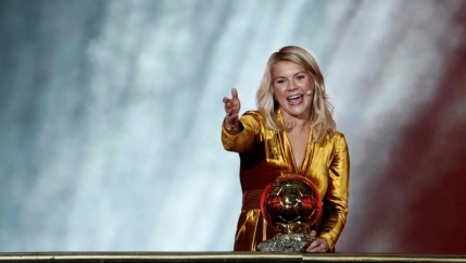 Soccer player Ada Hegerberg holds the Ballon d'Or trophy