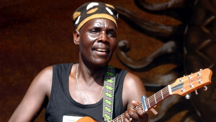 Oliver Mtukudzi plays guitar
