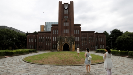 two students stand outside the Yasuda auditorium at the University of Tokyo
