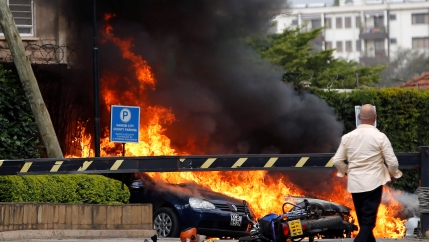 Car ablaze near hotel rocked by terrorist attack.