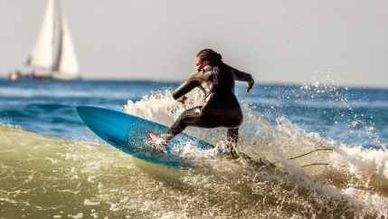 A woman riding a wave