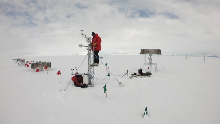 Researchers Scott Landolt and Mark Seefeldt set up an automatic snowfall measuring system in Antarctica.