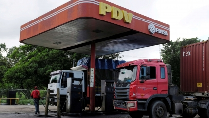 The corporate logo of Venezuelan state-owned oil company PDVSA is seen at a gas station sign