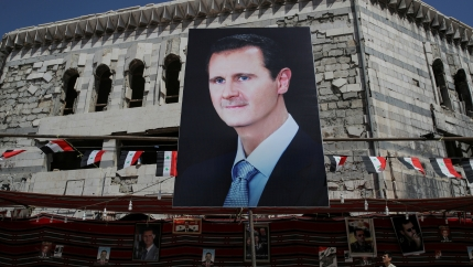 A huge banner of Bashar al-Assad.