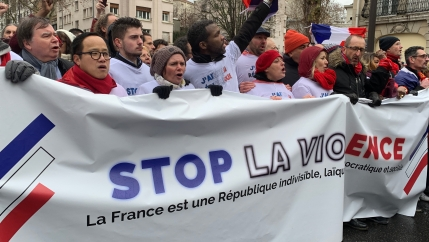 Protesters hold an anti-violence banner in Paris.