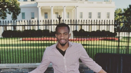 Alex Bukasa, a Congolese asylum-seeker and former journalist, poses in front of the White House.