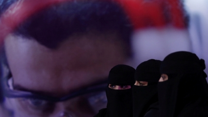 Three women in Saudi Arabia wearing black.