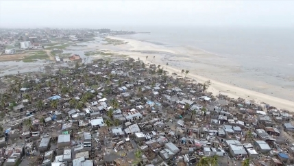 A still photo taken from drone footage above a settlement on the edge of Beira, Mozambique showing dozens of buildings flooded.