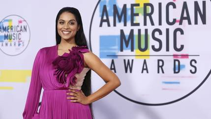Lilly Singh poses in a magenta gown