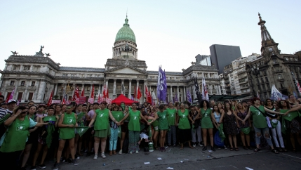 Activists hold hands outside the National Congress in Argentina.