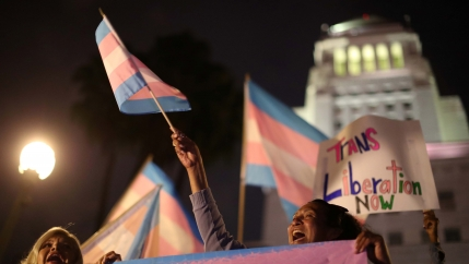 Women protest with transgender flags