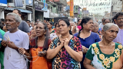 Crowds holding candles and rosaries pray in the week following the Easter Sunday suicide bombings in Sri Lanka.