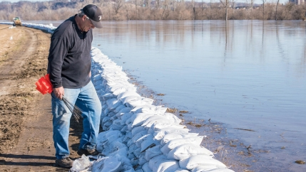 a man inspects a levee in kansas