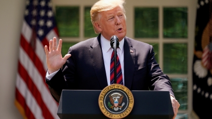 US President Donald Trump delivers remarks on immigration reform at a podium in the Rose Garden of the White House in Washington, DC, May 16, 2019