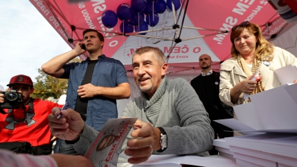 The leader of ANO party Andrej Babis signs books for a supporter during an election campaign rally in Prague, Czech Republic September 28, 2017.
