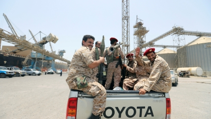 emen's Houthi movement forces ride in the back of vehicle during withdrawal from Saleef port in Hodeidah province