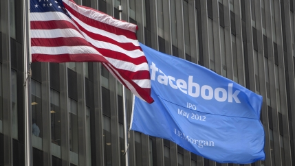 A flag announcing the IPO of Facebook flies next to the American flag outside the offices of JP Morgan in New York City, New York May 4, 2012.