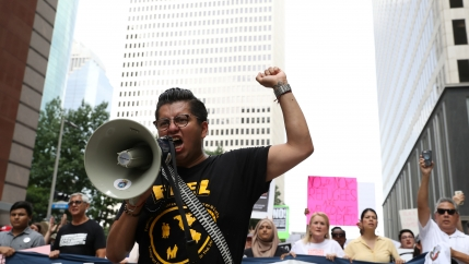Cesar Espinosa, an immigrant rights' activist and head of FIEL, leads demonstrators protesting the Trump administration's immigration policies as part of a