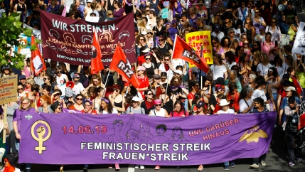 Protesters carry banners and placards at a demonstration during a women's strike (Frauenstreik) in Zurich, Switzerland June 14, 2019.