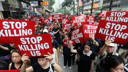 Protesters hold placards as they attend a demonstration demanding Hong Kong's leaders to step down and withdraw the extradition bill, in Hong Kong, China, June 16, 2019.