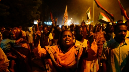 Sudanese people, seeking to revive a push for civilian rule in ongoing tumult since the overthrow of former President Omar al-Bashir more than two months ago, chant slogans and wave Sudanese flags during a demonstration in Khartoum, Sudan, June 21, 2019.