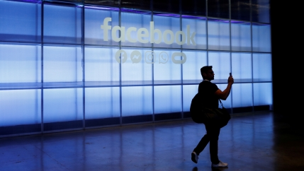 a man walks in a hallway at facebook