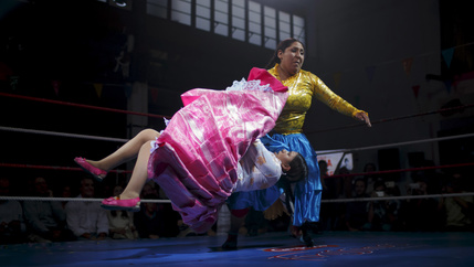 two Bolivian women square off in a wrestling ring
