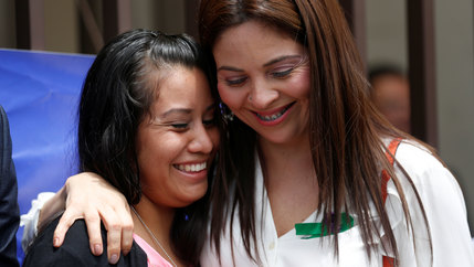 Evelyn Hernández, who was sentenced to 30 years in prison for a suspected abortion, is hugged by a woman.