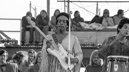 Jimi Hendrix plays at Woodstock.