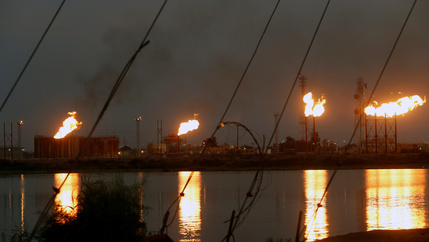 Flames emerge from flare stacks at Nahr Bin Umar oil field, north of Basra, Iraq, on Sept. 16, 2019.