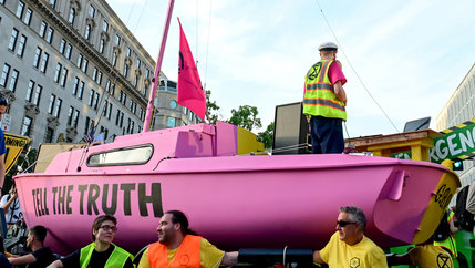A sailboat is shown painted pink with the words,