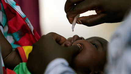 A child is given an oral vaccine.